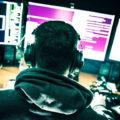 Хакер перед компьютерами